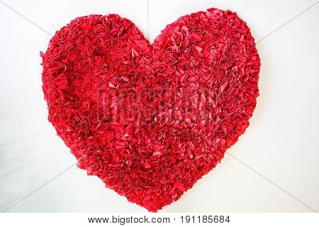 isolated bright red cloth carpet in heart shape