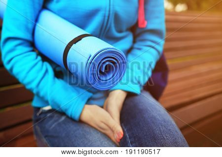 Woman Hold Blue Fitness Mat Close-up