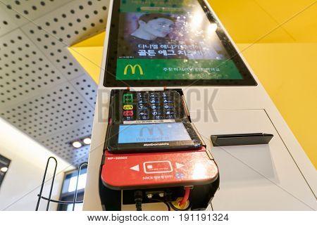 SEOUL, SOUTH KOREA - CIRCA MAY, 2017: close up shot of McDonald's ordering kiosks payment terminal. McDonald's is an American hamburger and fast food restaurant chain.
