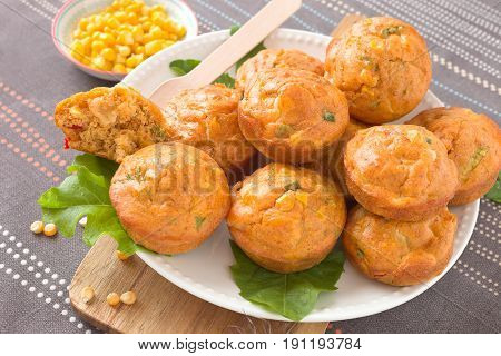 Homemade savory muffins with corn, cheese and pepper.