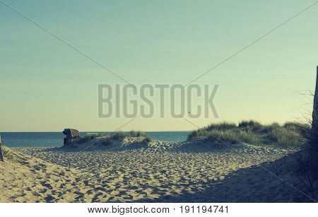 Sunrise at the beach Baltic sea with beach chairs and dune grass