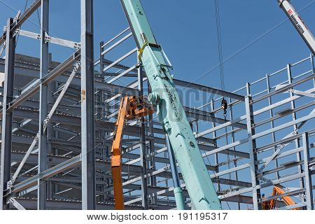 KELSTERBACH, GERMANY-JUNE 14, 2017: Steel construction of an industrial building under construction