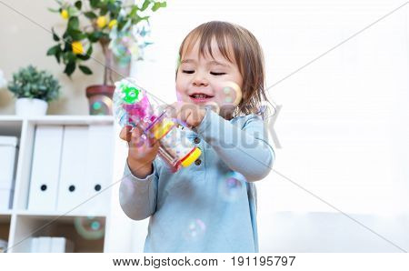 Toddler Girl Playing With Her Bubble Gun