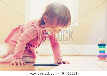 Happy Toddler Girl Playing With Her Tablet Computer