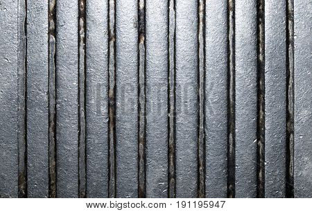 Grooved metal closeup background.