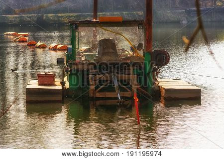 Dredger Floating excavator when dredging of soil sand and silt from a river.