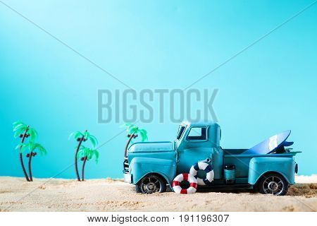 Miniature Blue Truck With Surfboard And Buoy