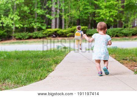 Toddler Girl Walking Away From Home