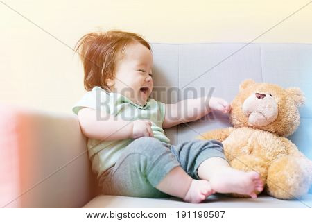 Happy Baby Boy With His Teddy Bear
