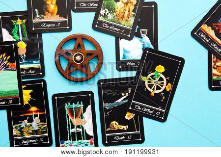 Tarot Deck - Tarot Readings With Wooden Pentagram Incense Burner On Blue Background
