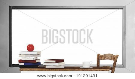 Piles of book on wooden table with blank whiteboard background