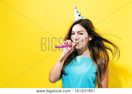 Young Woman With Party Hat With Noisemaker