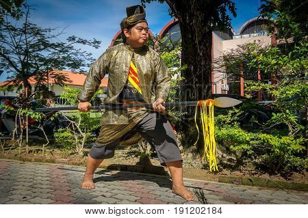 Labuan,Malaysia-May 21,2017:A Malay man with the traditional malay warrior costume during performed at Malay Wedding Ceremony at Labuan,Malaysia on 21st May 2017.
