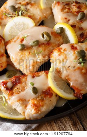 Fillet Chicken Piccata With Lemon, Thyme And Capers Close-up. Vertical