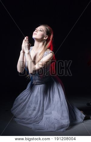 Actress In A Grey Dress On A Dark Stage
