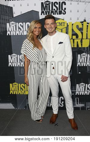 NASHVILLE, TN-JUN 07: Morgan Wallen (R) and Katie Smith attend the 2017 CMT Music Awards at the Music City Center on June 7, 2017 in Nashville, Tennessee.