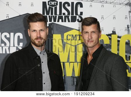 NASHVILLE, TN-JUN 07: Curtis Rempel (L) and Brad Rempel of High Valley attend the 2017 CMT Music Awards at the Music City Center on June 7, 2017 in Nashville, Tennessee.