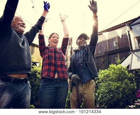 Diverse People Hands Up Cheerfully