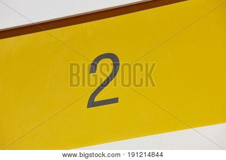Hotel room number in yellow background. Tourist apartment. Vacation