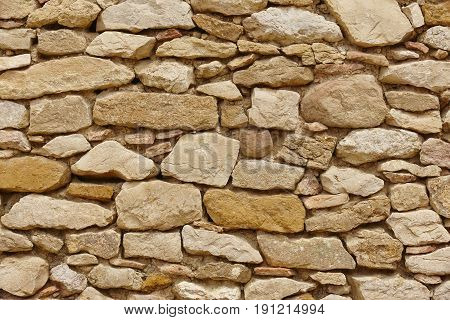 Stone wall background. Rock textured surface. Rough material. Horizontal