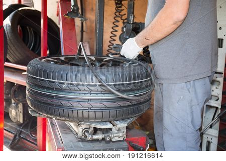 Technician Specialist Changes Car Tire With His Machine