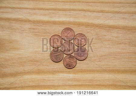 Old Latvian Coins On A Wooden Background