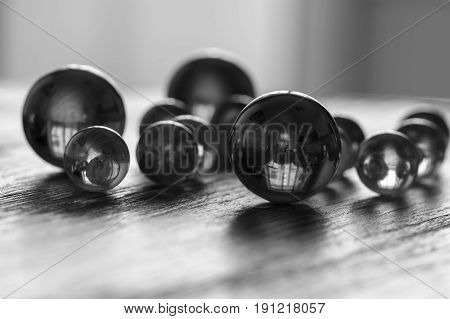 Black white photo with glass balls. Glass balls of different sizes.