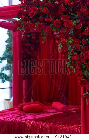 Red Bed And Flowers.