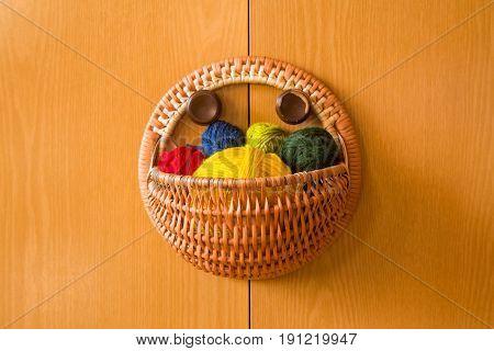 A Beautiful, Colorful Yarn Balls In A Handmade Basket