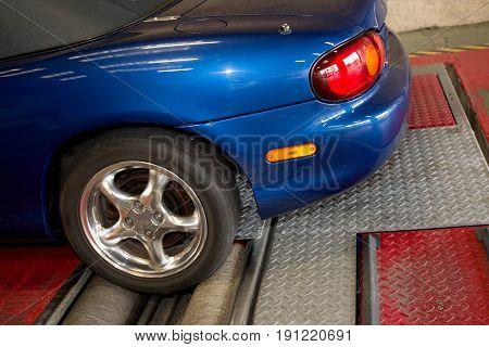 Automotive Suspension And Brake Test Rolls In A Garage Test Center