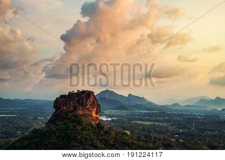 Sigiriya Sri Lanka. Sunset over the Lion Rock in Sigiriya Sri Lanka. Aerial view of the tropical forest with mountains