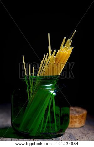Spaghetti container jar on wooden table, close up