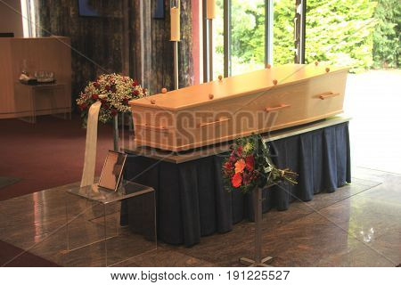 Plain light wooden coffin in a crematorium