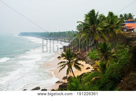Kerala India. Varkala beach with various cafes and restaurants at the cliff with Laccadive Sea and Varkala beach in Kerala India