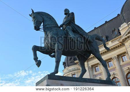 Statue of king Carol I. Typical urban landscape in the center of Bucharest - Bucuresti. Bucharest is the capital of Romania. Bucharest have 3 millions inhabitants and many historical vestiges.