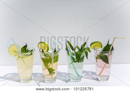 Lemonade with mint and lime against white background