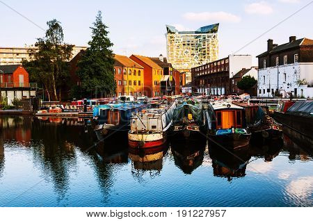 Birmingham UK. Boats moored in the evening at famous Birmingham canal in UK
