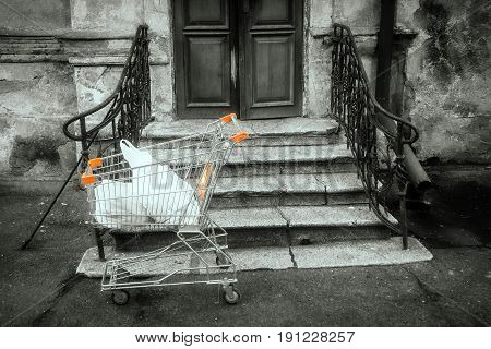 Shopping cart on the background of an old house