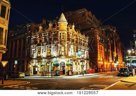 BIRMINGHAM UK - SEPTEMBER 1 2014: The building of Old Royal Pub an example of characteristic Victorian red brick and terracotta architecture in the center of the city Birmingham UK at night.