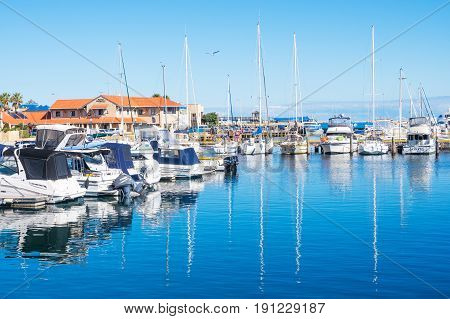 HILLARYS, AUSTRALIA - MAY 25 ,2017: Boats moored at Hillarys Boat Harbour, a marina and tourist precinct located in Hillarys, north of Perth in Western Australia.