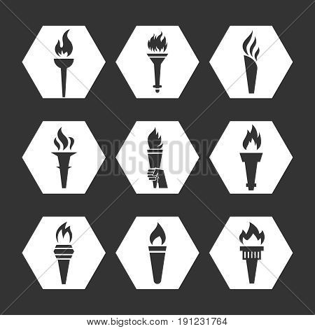 Grey flat torch with flame icons set. Monochrome torch icons collection. Vector illustration