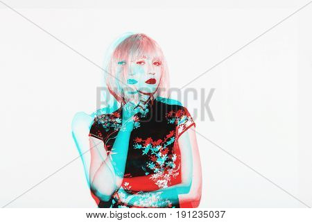 Double exposure asian woman in white wig. Beautiful japanese geisha in sakura blossom clothes design.