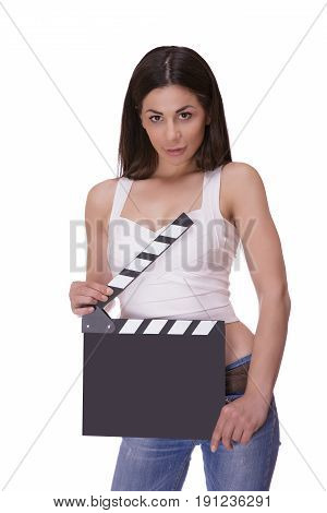 Beautiful smiling woman holding a movie clapper. Girl helps in shooting a movie. Isolated on a white background