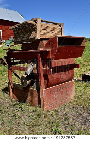 OSAKIS, MINNESOTA, June 5, 2015: The  antique Clipper @B fanning mill for sale at an auction is a product and was manufactured by the A.T. Ferrell Company, Inc.  of Bluffton, IN since 1869.