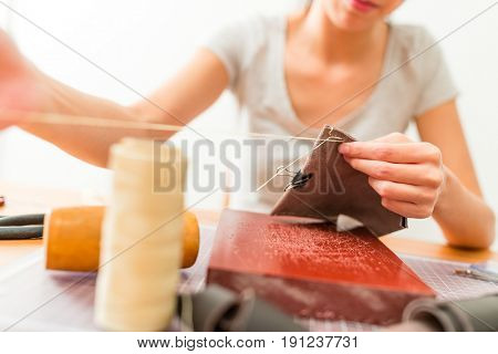 Leather craftsman making a bag