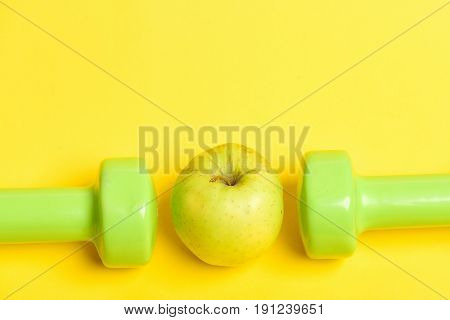 Dumbbells In Juicy Green Colour And Ripe Greenish Yellow Apple
