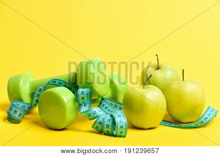 Dumbbells And Apples Composition: Apple Fruit, Sport Units And Tape