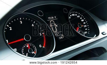 Vehicle Dashboard Speedometer. A Modern car details.