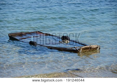 image of wooden fishing boat submerged in water