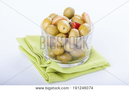 Bowl Of Homemade Olives On A Glass, Typical Spanish Tapa, Isolated On White Background